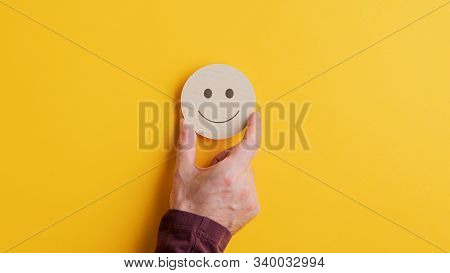 Wooden Cut Circle With Smiling Face On It