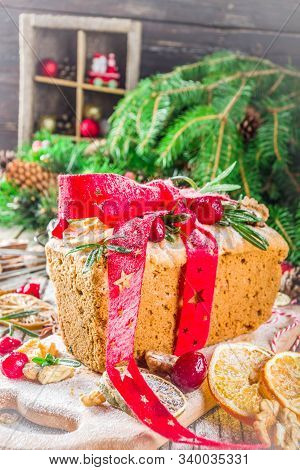 Traditional Christmas And Winter Holidays Baking. Fruit Cake With Icing, Nuts, Berry Dry Orange And