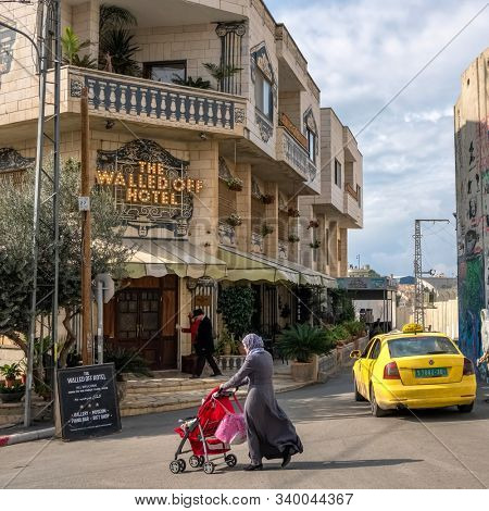 Bethlehem, Palestine - November 22, 2018: Walled Off Hotel set up and decorated by famous artist Banksy near the separation wall in West Bank, Palestine
