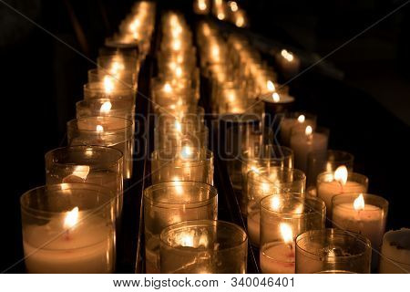 Rows Of Lit Candles For Religious Ceremony