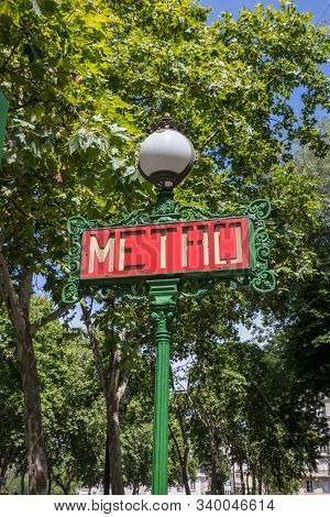 Red Metro Sign On Green Pole In Paris France