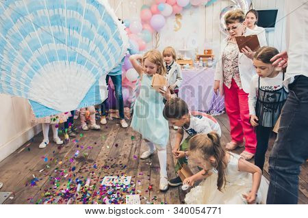 Perm/russia - June, 28, 2019: Little Girl Is Going To Broke The Pinata. Children Birthday Party.