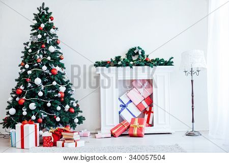 Christmas Tree With Lights Garlands Adorned With New Year Holiday Gifts