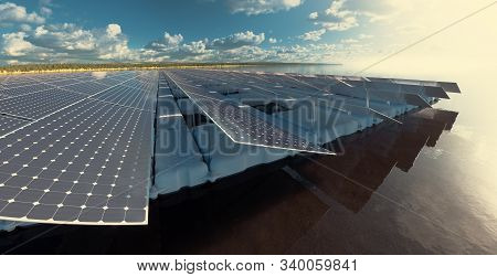 Floating Solar Power Plant Fam On Calm Lake  In Late Afternoon Time With Beautiful Forest Landscape