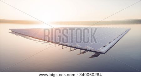 Aerial Image Of  Floating Solar Power Plant Farm On Calm Lake  In Beautifull Sunset Sunlight With Mi