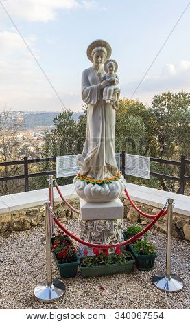 Jerusalem, Israel, December 07, 2019 : The Statue Our Lady Of La Vang With A Baby In Her Arms In The