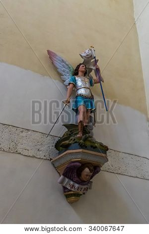 Jerusalem, Israel, December 07, 2019 : Statue Of An Angel With A Sword On A Wall In Our Lady Of The