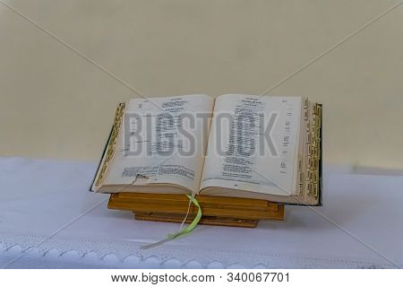 Jerusalem, Israel, December 07, 2019 : An Open Holy Book Lies On A Table In Interior Of The Our Lady