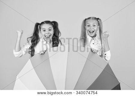 Excited Children. Girls Friends With Umbrella. Rainy Day. Happy Childhood. Kids Happy With Umbrella.