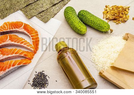 A Piece Of Raw Trout Fillet (salmon) With Parsley, Salt And Green Pepper. Ingredient For Cooking Hea