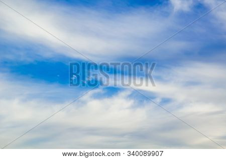 Beautiful Feathery Clouds In The Blue Sky