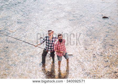 Fishing Freshwater Lake Pond River. Male Hobby And Sport Activity. Fishermen Fishing Equipment. Summ