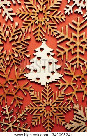Beautiful Handmade Wooden Snowflakes On Blue New Year Background Shot In Close Up.hand Crafted Chris