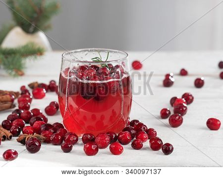 Fresh Cranberry Drink In A Glass Cup On A Wooden White Background. Close-up. Horizontal Orientation.