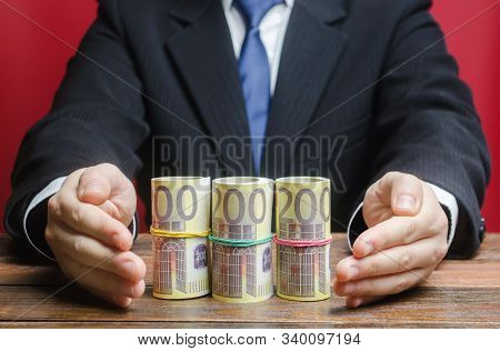 Businessman Covers With Hands Euro Money Protection Gesture. Provision Money, Credit, Grant. Project