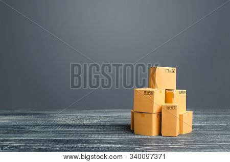 Stock Pile Of Cardboard Boxes. Production Goods And Products, Distribution And Trade Exchange Goods,