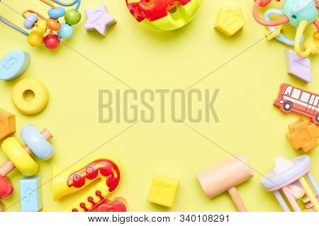 Top View On Childrens Toys On A Blue Background. Childrens Toys On The Table. Concept For Advertisin
