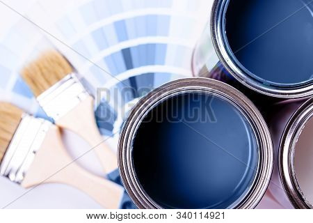 Paint Brushes Placed On Top Of Can Filled With Blue Paint. Classic Blue Color Of Year 2020