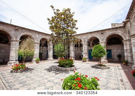 Courtyard With Trees And Flowers In Monastery Saint Catalina, Arequipa, Peru, Closed From Prying Eye