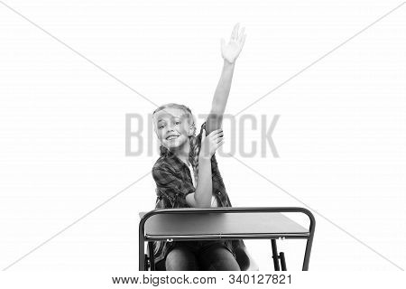 She Is Up On Her Homework. Adorable Small Child Raising Hand To Recite Homework Isolated On White. D