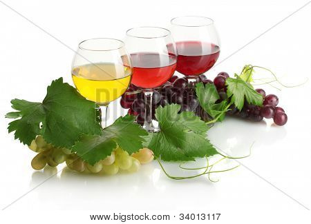 glasses of wine and ripe grapes with leaves isolated on white