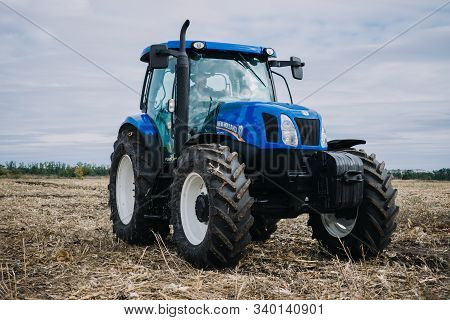New Blue Tractor Holland In Motion At Demonstration Field Site At Agro Exhibition Agroexpo. Tractor