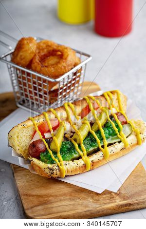 Chicago Hot Dog On A Poppy Seed Bun Topped With Tomatoes And Sweet Relish