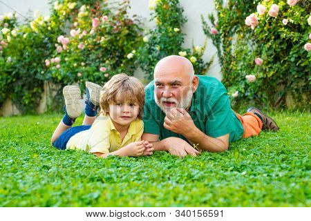 Grandfather And Grandson Playing - Family Time Together. Cute Boy With Dad Playing Outdoor. Father A