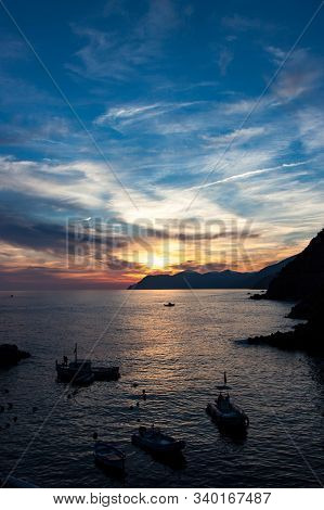 Vertical Crop Of Dramatic Sunset By Italian Coastline In Cinque Terre