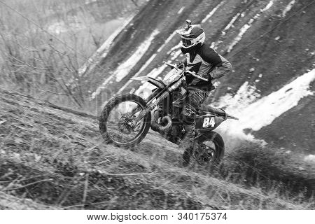 Enduro Rider Makes A Race On An Enduro Motorcycle Through The Mountains And Hills In Winter