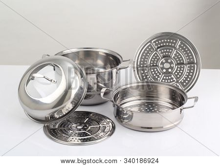 Set Of Stainless Steel Pots Isolated On White Background
