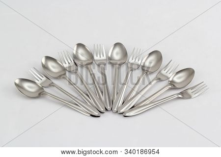 Kitchenware Set Of Stainless Steel Spoons And Forks Isolated On White Background