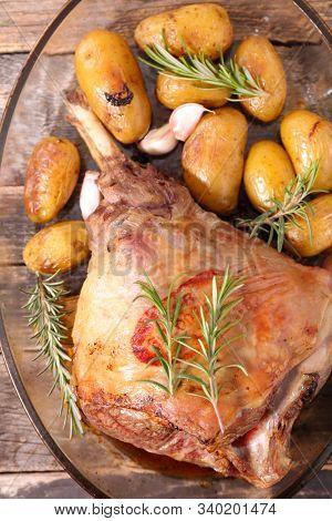 roasted lamb leg with potatoes and rosemary