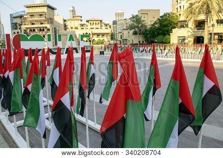 Dubai / Uae - December 3, 2019: A Lot Of Uae National Flags With Souk Al Bahar On Background. I Love