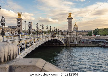 Paris, France - 7.10.2019. View On  Bridge Pont Alexandre Iii In Paris. Sunset In Paris. Stunning Po