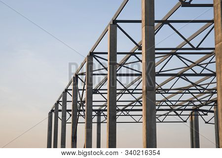 Metal Construction Site, Steel Structure Is Under Construction Against Evening Sky