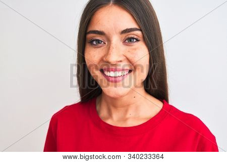 Young beautiful woman wearing red casual t-shirt standing over isolated white background with a happy face standing and smiling with a confident smile showing teeth