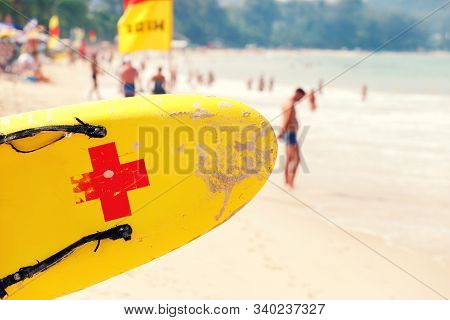 A Lifeguard Rescue Surf Board On Beach By The Sea. Life Saving Yellow Board.