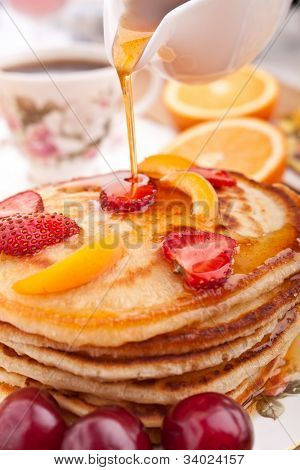 stack of pancakes slathered with syrup and coffee poster