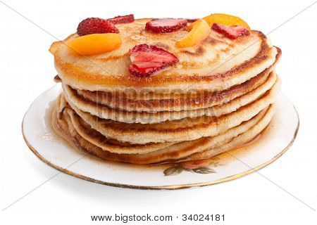 stack of pancakes with syrup and fruit poster