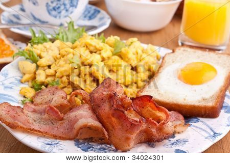 eggie bread, scrambled eggs and fried bacon poster