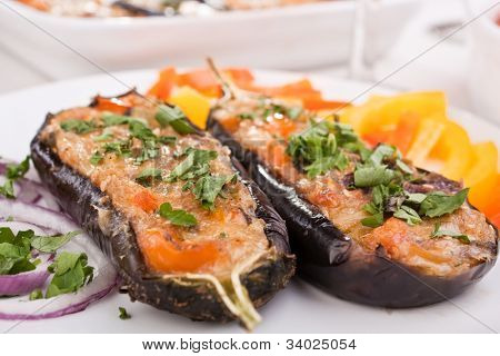 stuffed with cheese and mushrooms aubergines on a plate