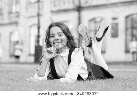 Its That Time Of Year Again. Relaxed Schoolchild. Happy Schoolchild Relax On Green Grass. Small Scho