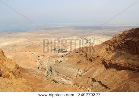 Judaean Desert Panorama With Wadis And Salt Lake Dead Sea Seen From Masada Fortress, Israel