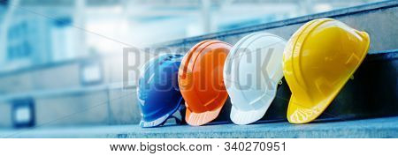 Multicolored Safety Construction Worker Hats. Teamwork Of The Construction Team Must Have Quality. W