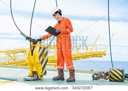 Mechanical Engineer Inspector Is Inspecting Lifting Equipment Of Pedestal Crane On Offshore Oil And