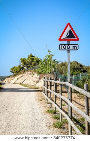 A Road Sign Loose Rock, Attention Scree