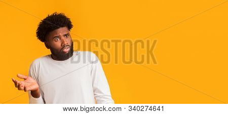 Unreal Offer. Amazed Black Young Man Looking At Free Space, Panorama