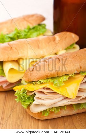 group of tasty ham, salami, turkey and beef sandwiches