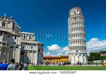 Pisa, Italy - June 6, 2019 : The Leaning Tower of Pisa is the campanile, or freestanding bell tower, of the cathedral of the Italian city of Pisa, known worldwide for its nearly four-degree lean. The tower is situated behind the Pisa Cathedral.